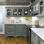 Vintage style kitchen with deep grey cabinets and a gorgeous tin ceiling