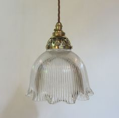 Run of three pendant lights in polished brass complete with holophane period glass shades. Priced for the set. c 1900 www.antiquelightingcompany.com