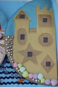 Matching shapes on the sandcastle. Beach quiet book page
