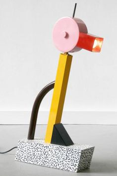 ENAMEL COATED: Nostalgic colour completes the look, with iconic early American pop culture inspiring a palette of true pastels and vivid brights. Tahiti lamp by Ettore Sottsass.