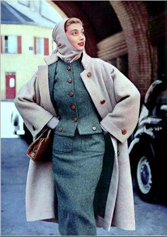 1954 Marie-Hélène in cozy wool coat worn with tweed suit and hooded sweater blouse, by Madeleine de Rauch, croc handbag by Prost, photo by Pottier,