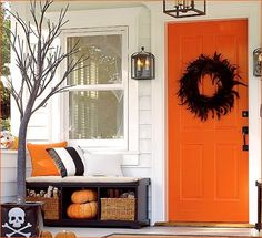 DIY Great Simple Orange and Black Porch Decor for Halloween - Make you own black feather wreath with a boa!