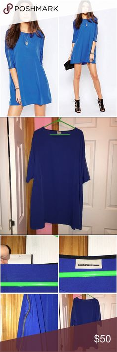 "Noisy May Tunic With Zip Detail Sleeves Only tried on; has been washed. Noisy May Tall brand from ASOS. Color is blue. Slinky woven fabric. 100% polyester. Zip detailed sleeves. Loose fit. Round neckline. Length laying flat is approx 35"". Stock photos from ASOS. ❌NO TRADES❌ ASOS Tops Tunics"