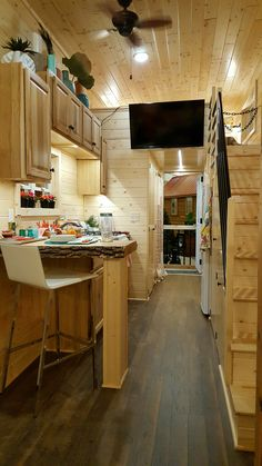 Tiny house view of galley kitchen and stairs to master loft