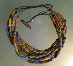 """A lovely mix of Venetian collectible beads: These beads are around 100 years old originally made in Venice for trade to the Africans, A mix of what is commonly called """"Chevrons' and """"Christmas beads"""", strung on waxed leather with a fantastic toggle clasp of beads!"""