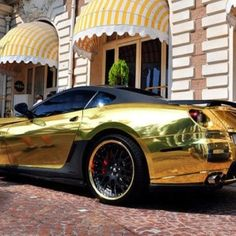 I think the awnings make the photograph. Gold car.