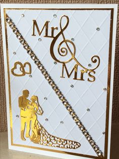 Gold and white wedding card.