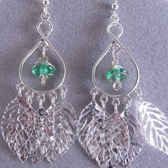 Chandelier Earrings NICKEL FREE with Green Wire Wrapped Beads and Leaf Beads (find feathers instead of leaves?)