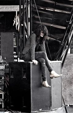 Alison Mosshart -- Style icon: Shiny boots, tight, slightly torn jeans, and an almost sweet long-sleeved top, paired with that waterfall of hair (my natural texture). Picture perfect.