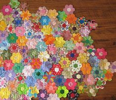 Mini hexagon quilt - I like the fact that the flowers are next to each other and they are scrappy!