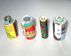 Turn AA batteries into C cells and D cells--  Just wrap some cardboard around the AA battery so it's the right diameter. They are already the same height. Wrap cardboard strips and fasten w/ tape or rubber bands.    New rechargeable AA batteries have plenty of power to run devices that used to require the bigger batteries.    I've seen commercial C and D cell batteries that are merely AA batteries with a plastic tube around them to bulk them up.