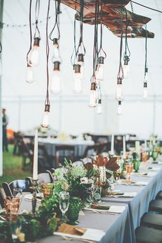 wedding reception with hanging bulbs, photo by Papered Heart Photography http://ruffledblog.com/brooksville-florida-wedding #weddingideas #weddingreception #tablescapes
