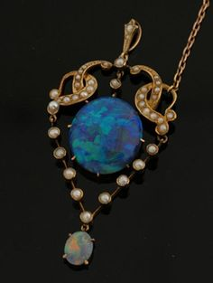 An Edwardian opal and seed pearl pendant,