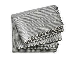 Throw in dark charcoal grey. Emipre throw has a timeless herringbone pattern.