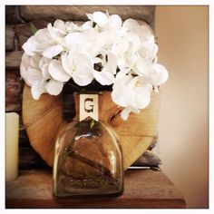 Old  recycled bottle with burlap and letter G.