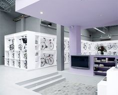Javier Maya's gorgeous Pave Bicycle Store in Barcelona, designed by Joan Saldovar, displays bikes as art. Cool Bicycles, Cool Bikes, Visual Merchandising, Shopping In Barcelona, Bicycle Store, Loft, Shop Interiors, Design Furniture, Retail Design