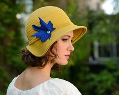 vienna gold felt hat with royal blue by behidadolicmillinery