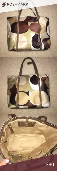 Small coach bag It's dark brown, tan, cream, and light green with cream interior. It has a few tiny markings on the outside. It's authentic Coach Bags