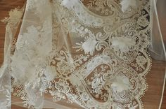 This gorgeous ivory 3D flower lace fabric to our lace fabric collection just at this early spring , special design from Korean customer for high end costumes, wedding gown, bridal dress .   This lace has matching scalloped edges on both borders, with an intricate 3D floral design running from the matching borders into the middle of the pattern k. We have hand embroidered a variety of 3D chiffon flowers onto an ivory tulle background.  Width is about 130 cm / 51 , price is for one yard, more…