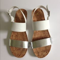 Restricted White and Silver Sandal Cute white and silver metallic sandals with cork footpad. Size 7. These have never been worn. No trades or Paypal please. NWOT. Restricted Shoes