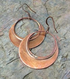 These copper hoop earrings are unique and very light weight! Hand cut and…