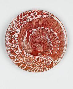William De Morgan A Small Ruby Lustre Peacock Charger, circa 1880