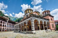Rila Monastery - Bulgaria, century fortress-like complex, the dwelling and tomb of St. John of Rila. Now Bulgaria's largest and most famous Eastern Orthodox monastery, housing around 60 monks Sofia Bulgaria, Hiking Tours, Voyage Europe, Natural Scenery, Angkor Wat, What A Wonderful World, World Heritage Sites, Cool Places To Visit, Day Trips