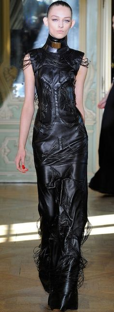 Great  leather outfit. Love the style, particularly the long look and the collar treatment
