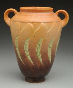 Peruse this slideshow to help you identify and value your Roseville Pottery pieces. Includes popular, more common patterns along with rarities.: Roseville Falline Vase