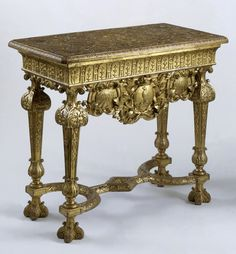 Table by James Moore about 1714. Pine frame and oak top, carved, gessoed and gilded Museum no. W.30-1947