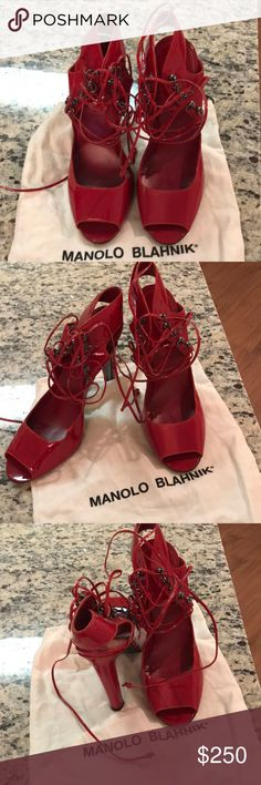 Red Manolo Blahnik lace ups Release you inner dominatrix with these red Manolo Blahnik lace ups. Barely worn. Original bag included. 3.5 inch heel. Manolo Blahnik Shoes Sandals