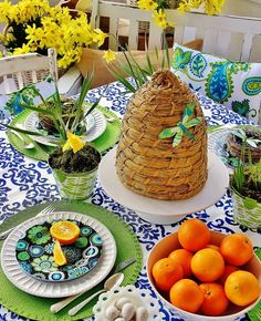 The table has an indoor/outdoor tablecloth with a blue damask pattern. Perfect for porch dining! Easter