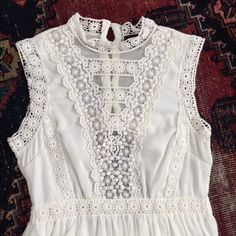 """White lace boho sundress Never worn, white, cotton and lace, high/ low, boho sundress.  Size small.  Polyester liner.  Buttons up in the back and zips on the side.  Perfect for a casual beach wedding!  Bust-30"""" from shoulder to from hem-45"""" shoulder to back hem-53"""" Dresses High Low"""