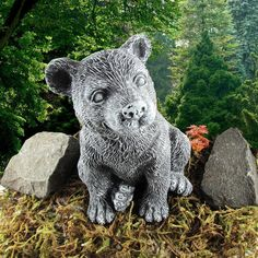 """Isn't he just the cutest thing you have ever seen?  This little bear cub is made of solid concrete and is 7"""" high. The color is dark grey with a lighter dry brush on the raised features. The finish has a protective sealer to keep it safe from the elements.  All of our concrete items are custom blended depending upon their use. Our intention is to allow the concrete to flow naturally so each piece is unique No mass produced items here, each one is hand crafted in our home studio."""
