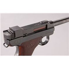 2nd Variation Lahti L-35 Semi-Automatic Pistol, #4366, 9mm, 4.7'' barrel, blue finish, brown checkered plastic grips with VKT logo, cut for shoulder stock, with rounded Loaded Chamber indicator; early narrow upper receiver marked ''VKT/L-35'' with yoke locking piece and protrusion eliminated; with etched letter ''E'' to right side Loading that magazine is a pain! Get your Magazine speedloader today! http://www.amazon.com/shops/raeind