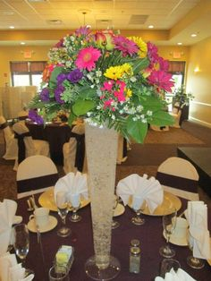 Tall vase floral display centerpiece #centerpiece #wedding #capriottiscatering #capriottispalazzo