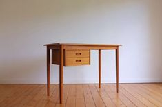 Classic Danish Modern teak desk c1960 (W105xD51xH73cm) Two drawers with recessed pulls, turned and tapered legs. Finished on all sides