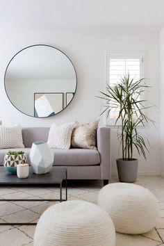 Round Mirror Grey Linen Sofa Rope Coil Ottomans Plant Modern Geometric Living Room Design Neutral But Interesting