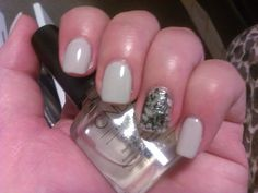 Shellac Cityscape and a black and silver foiled accent finger.