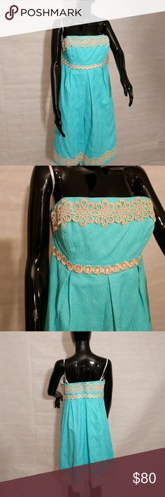 Lilly Pulitzer teal strapless dress Lilly Pulitzer size 10 teal strapless dress with gold trim around bust and at bottom of dress. Built in bra. Shell 100% cotton exclusive of trim. Lining 100% cotton. Lilly Pulitzer Dresses Strapless
