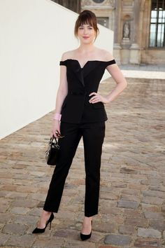 Dakota Johnson wearing Lady Dior Bag in Black Lambskin, Dior Perle Bracelet, Dior Mise En Dior Tribal Earrings and Thierry Lasry Peroxxy Sunglasses