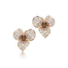 Diamond stud earrings from the Floral Collection in 18K rose gold.  Three pave diamond petals frame a cognac diamond center.