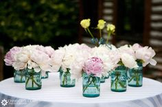 Pink and white wedding centerpiece. Peonies in mason jars