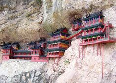 Splendid China Hanging Temple Built in 491, Hanging Monastery is an architectural wonder because it hangs on the west cliff of Jinxia Gorge more than 50 meters above the ground #Travel #China