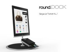 ROUND dock 01  . Contest RE-DOCK    ELEGANCE PAYMENTS A pedestal that allows the rotation 360°(vertical axis) indipendent of the Ipad and Mpos. Made of melting Aluminum or welding Iron and It will make the product sculptural...
