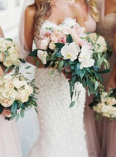 How stunning is this bride's orchid bouquet & floral applique dress? Photography : Joey Kennedy Photography Read More on SMP: http://www.stylemepretty.com/pennsylvania-weddings/bedford-pennsylvania/2016/06/03/the-ultimate-black-tie-affair/
