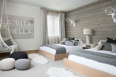 Scandinavian bedroom with wooden accent wall and pops of gray