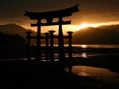 Dusk darkens the torii, a gate built as the entrance to a Shinto shrine, on Miyajima.  Photograph by Paul Whitton, My Shot