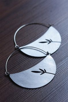 Modern Cresent Shaped Hoop Earrings with Leaf Graphic. $64.00, via Etsy.