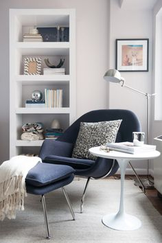 Creative Wall Shelves Plus Black Lounge Chair Plus Round White Table On Modern Reading Nook Design
